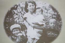 Mazie with her family when she was young